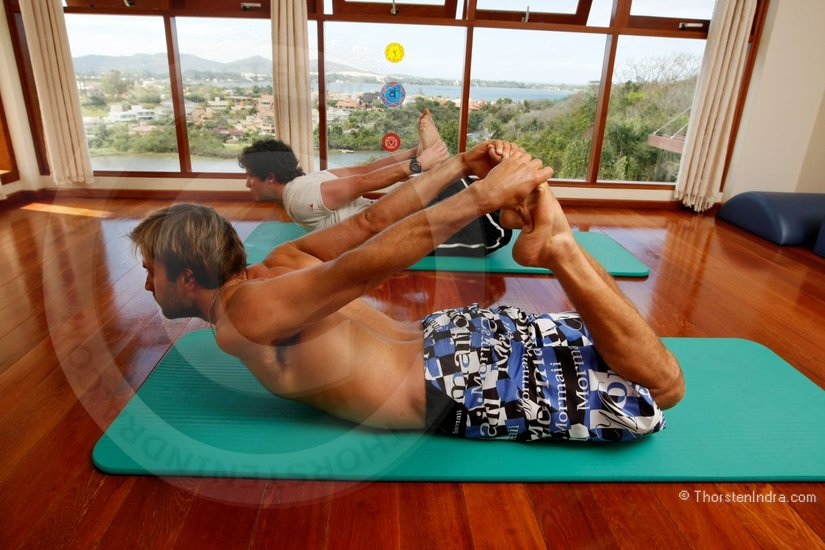 Kauli Seadi (BRA-253) (JP, Neil Pryde, Mormaii) with his Pilates instructor doing stretching and doing Pilates exercises in Florianopolis . Windsurfing warm-up excercises