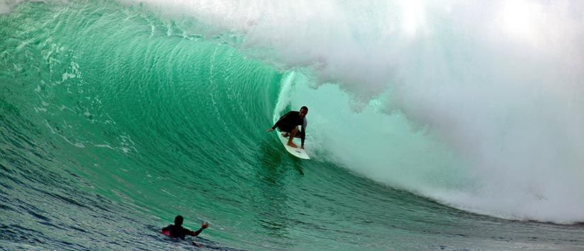 Surfing massive tubes at Honolua Bay/ Maui , Hawaii - Click for the Surfing Gallery